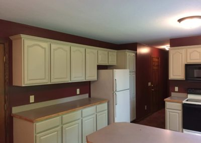Oak-Kitchen-Cabinets-Painted-Off-White-With-Deep-Red-Walls