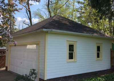 freshly-painted-white-siding-on-garage-exterior