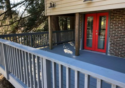 freshly-painted-grey-deck-with-red-door