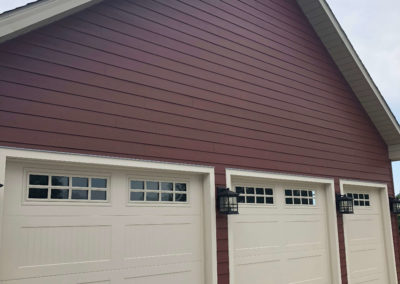freshly-painted-red-siding-house-exterior