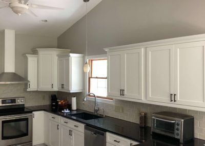 freshly-repainted-refinished-white-kitchen-cabinets